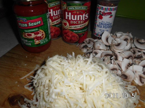 Slice mushrooms, grated cheese, and drain as much juice out of diced tomatoes as...