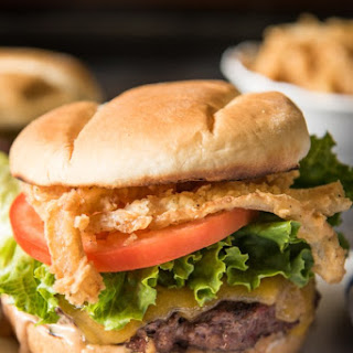 All-American Hamburger with Crispy Onion Strings & Burger Sauce.