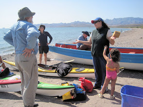 Photo: Departure south of Loreto. Ivette represents the company (Sea Kayak Baja Mexico) that provided our guide and kayak equipment. She's here with her daughter Nathalia. We pack up the kayaks. The first day they are stuffed to the max with food, water, clothes, books, cameras, camping gear. As food and water get consumed during the trip, the packing gets easier.