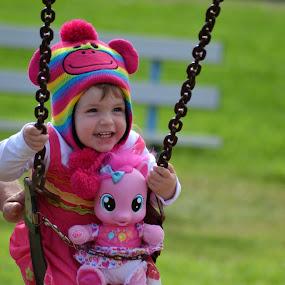 loving it by Justine McGrath - Babies & Children Children Candids ( child, green, laugh.grass, swing,  )