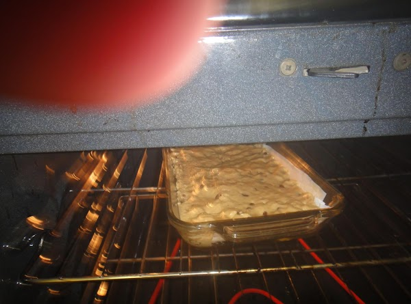 375 degrees F. Preheat Grease 8 x 11 or 9 x 13  pyrex...