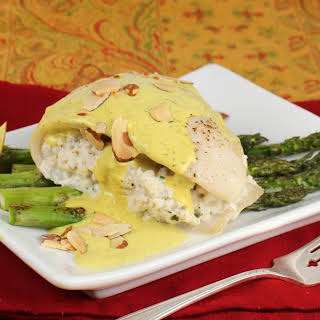 Crab Stuffed Tilapia with Asparagus and Creamy Curry Sauce.