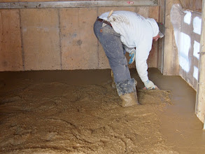 Photo: Working the cement in the upper level of the Race Hutch.