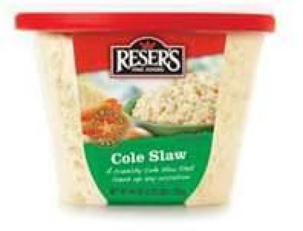 Blend in the prepared coleslaw and mix thoroughly.