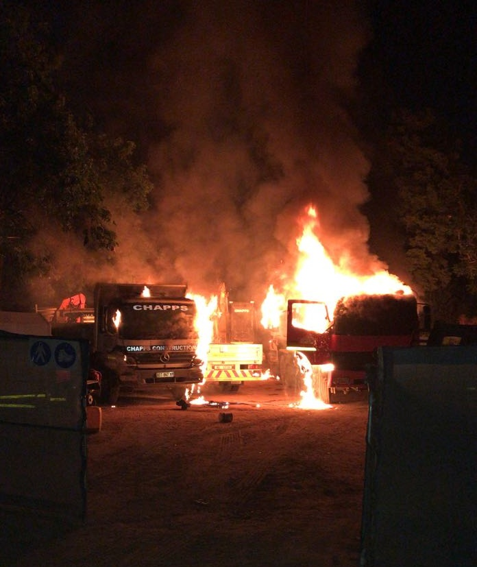 Equipment worth millions was razed after a gang torched a construction site.