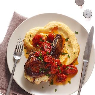 Mozzarella-Stuffed Pork Chops with Polenta and Tomatoes recipe | Epicurious.com.