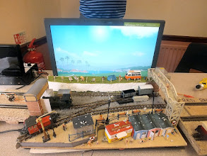 "Photo: 012 Richard Standing's 009 ""The Seaside Layout"" which is a suitably descriptive and imaginative name. The layout is sub-titled ""Where Seagulls Dare"" in the programme, which I think that judging by the white splodges seen on the roofs of the beach huts, they did! ."