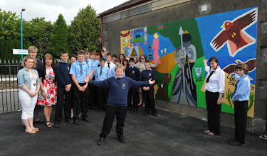 Photo: Young people from Ysgol Gyfun Pantycelin celebrating work achieved at Llandovery as a result of the Carmarthenshire youth service initiated project and workshops facilitated through Arts Care Gofal Celf artist, Veronica Gibson.