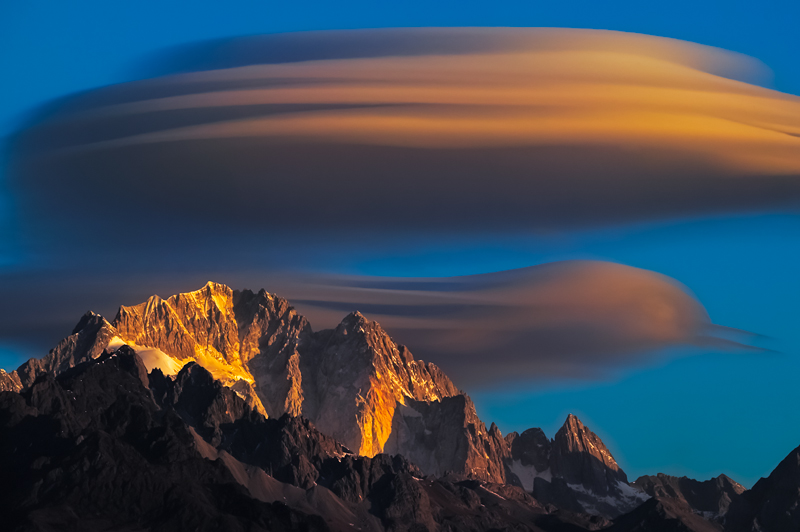 Photo: Shot of the Day - We lived in Lijiang in Yunnan, China for about 3 years, and these are the only significant lenticular clouds we saw. I was cycling 25km over to the lake to photograph birds and the shortest lens I had with me was Juanli's 300/2.8. This is full frame on a Canon 1Ds.