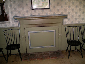 Photo: parlor fireplace, Parsonage, closed for summer. These panels could be made to match the wainscot, or wallpapered, or decoratively painted with scenes or flowers.