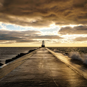 Jetty Sunset by Greg Croasdill - Buildings & Architecture Bridges & Suspended Structures ( clouds, michigan, lake michigan, luddington, sunset, lighthouse,  )