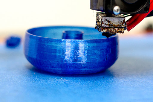 3D Printing PLA filament material On Blue Tape