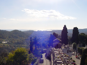 Photo: From a high point on the south ramparts, the Mediterranean can be seen in the distance. In the small cemetery below is buried artist Marc Chagall.