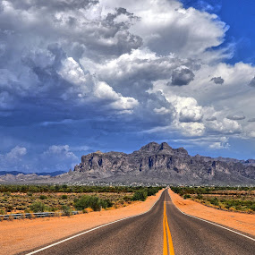 Roadway to Infinity... by Stephen Botel - Landscapes Deserts ( clouds, mountains, desert, highway, thunderstorm, shrubbery, rain, cactus )