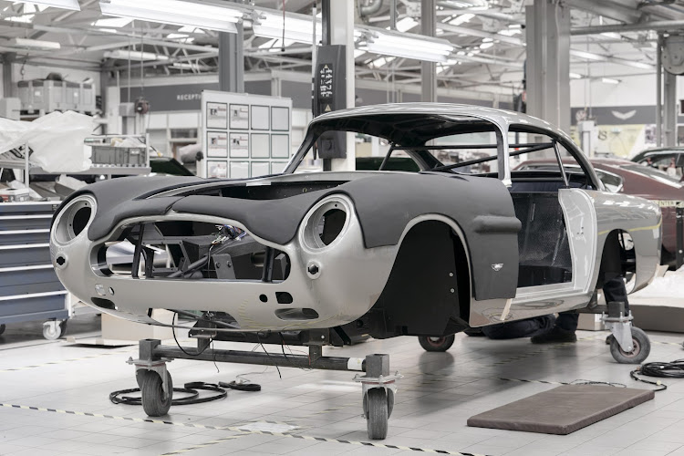 More than 55 years after the last new DB5 left Aston Martin's UK factory, work is again under way on DB5 Goldfinger Continuation cars. Picture: SUPPLIED