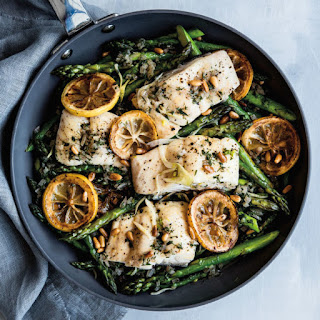 Halibut with Lemon, Herbs and Sautéed Asparagus.