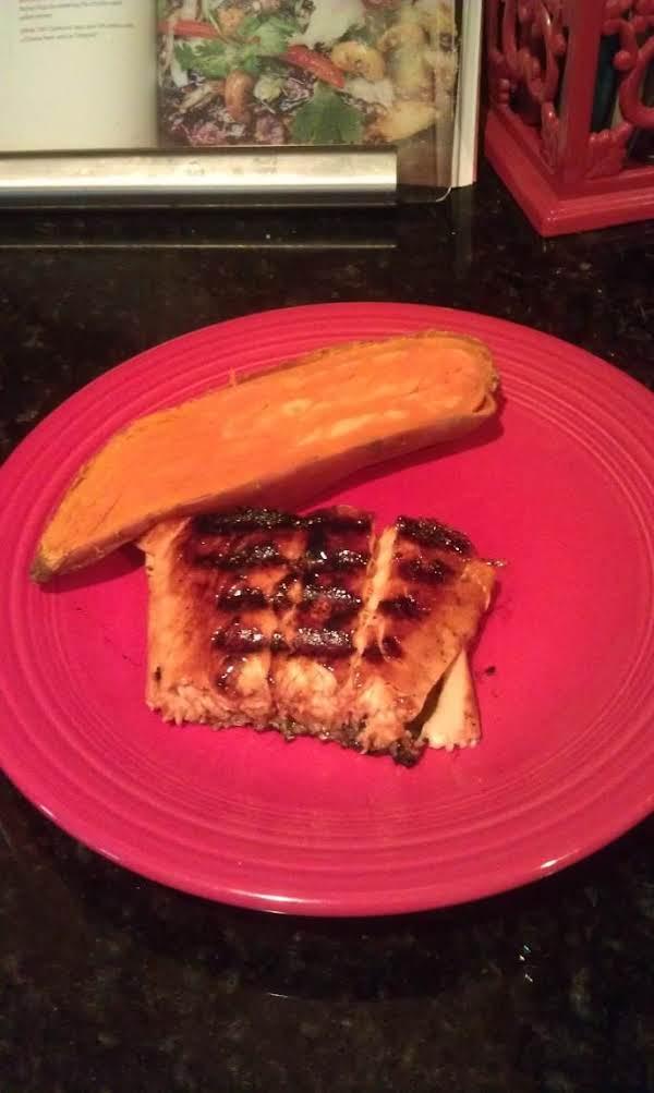 Blackened Terriyaki Brown Sugar Salmon Served With A Side Of Sweet Potatoe.