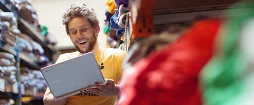 man looking at laptop and smiling