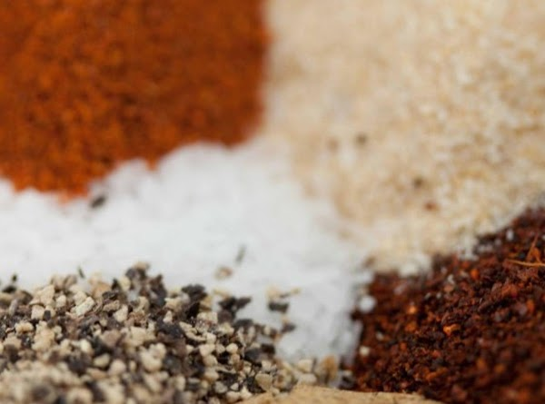 Add salt, chili powder, garlic powder, red pepper and  black pepper, then cover...