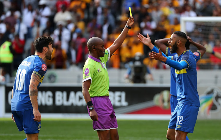 Thando Ndzandzeka, Match referee shows a yellow card to Taariq Fielies of Cape Town City during the Absa Premiership 2018/19 football match between Cape Town City FC and Kaizer Chiefs at Cape Town Stadium, Cape Town, 15 September 2018.