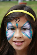 Photo: Butterfly face paint mask by Tess, Long Beach, Ca. Call to Book Tess at 888-750-7024