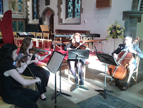 Photo: String quartet providing some pre-concert music before the evening concert at St Paul's Without, Canterbury, on day five of Summer Music Week.