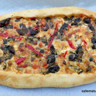 Turkish Flat Breads with Spinach, Feta and Peppers; Peynirli Pide.