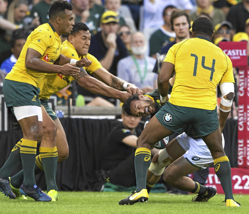 Crystal clear: Australia's Israel Folau tugs at Dillyn Leyds' hair during the Test in Bloemfontein on Saturday. Picture: DIRK KOTZE/GALLO IMAGES
