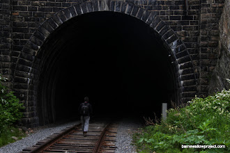 Photo: Georgy enters the mouth of a long tunnel of the Baikal railway (construction of the railway cost the lives of 2,000 prisoners and exiles)