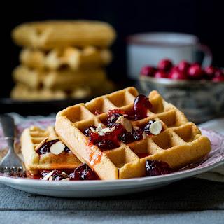 Almond Waffles With Cranberry Orange Honey Syrup.