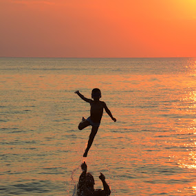 Father and son by Tasos Triantafyllou - People Family ( games, sunset, shadow, sea, fun, fantastic, people,  )