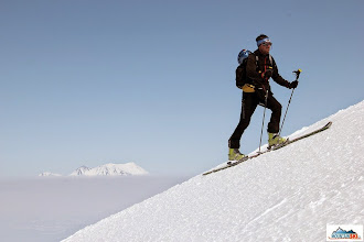 Photo: Pazout running up the hill, volcano Zhupanovsky in the background behind Nalychevo's valley.
