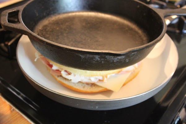 Top sandwich with heavy pan or skillet and press down. I used a cast...
