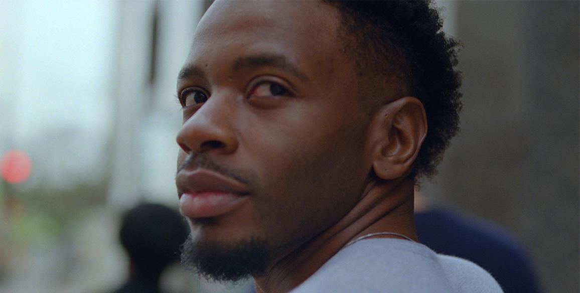 close up of man looking back at camera