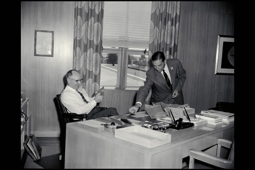 Smith J. DeFrance and J.F Parsons in Directors office.
