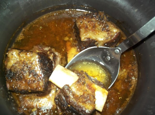 Place ribs in crock pot with water and cook on high for 4 to...
