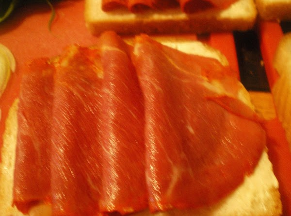 Top two slices of bread with about 4 slices of capicola.  I like...