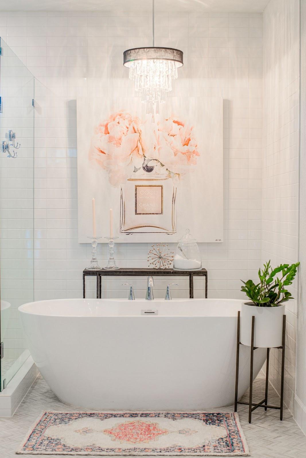 builder-grade home after custom interior design freestanding bathtub and art