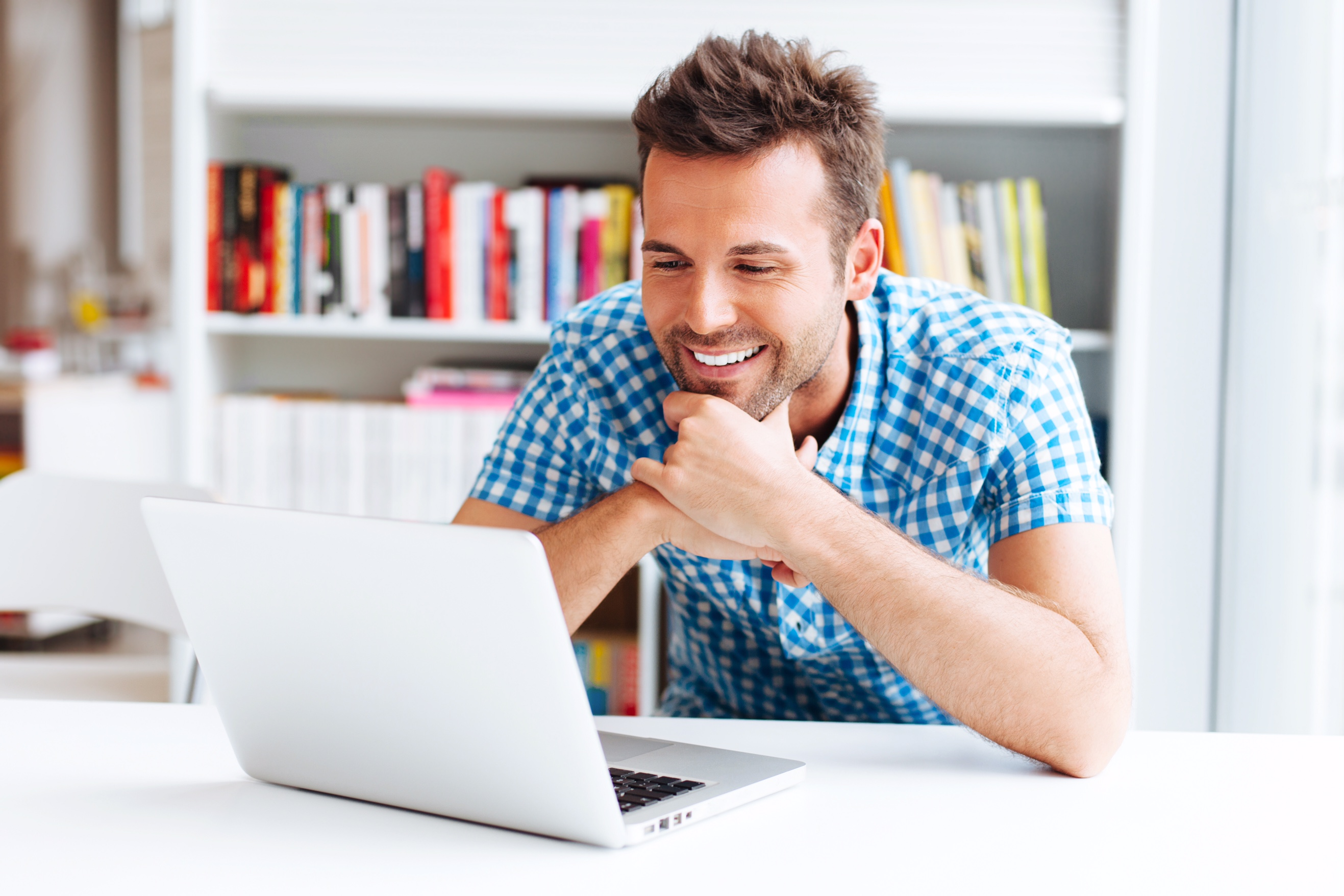 Happy man reading information online
