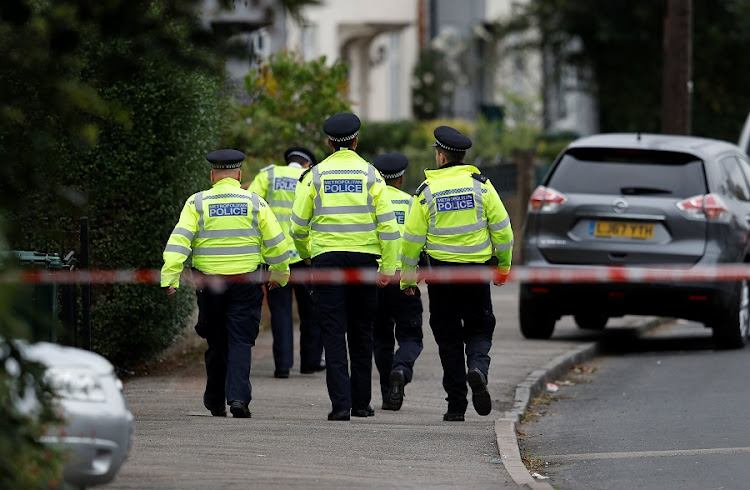 Police officers walk behind cordon tape set up around a property being searched after a man was arrested in connection with an explosion on a London Underground train, in Sunbury-on-Thames, Britain, September 17, 2017. Picture: REUTERS/PETER NICHOLLS