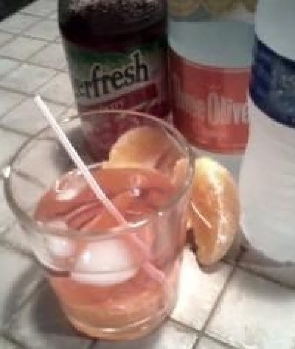 In a cold glass with few icecups add vodka and cranberry juice. Pour water...