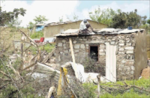 AFTERMATH: KwaZulu-Natal Premier S'bu Ndebele on  Saturday visited the Molwebi are which was ravaged by a storm that left several houses destroyed. 15/11/2008. Pic. Siyabonga Mosunkutu.  © Sowetan.