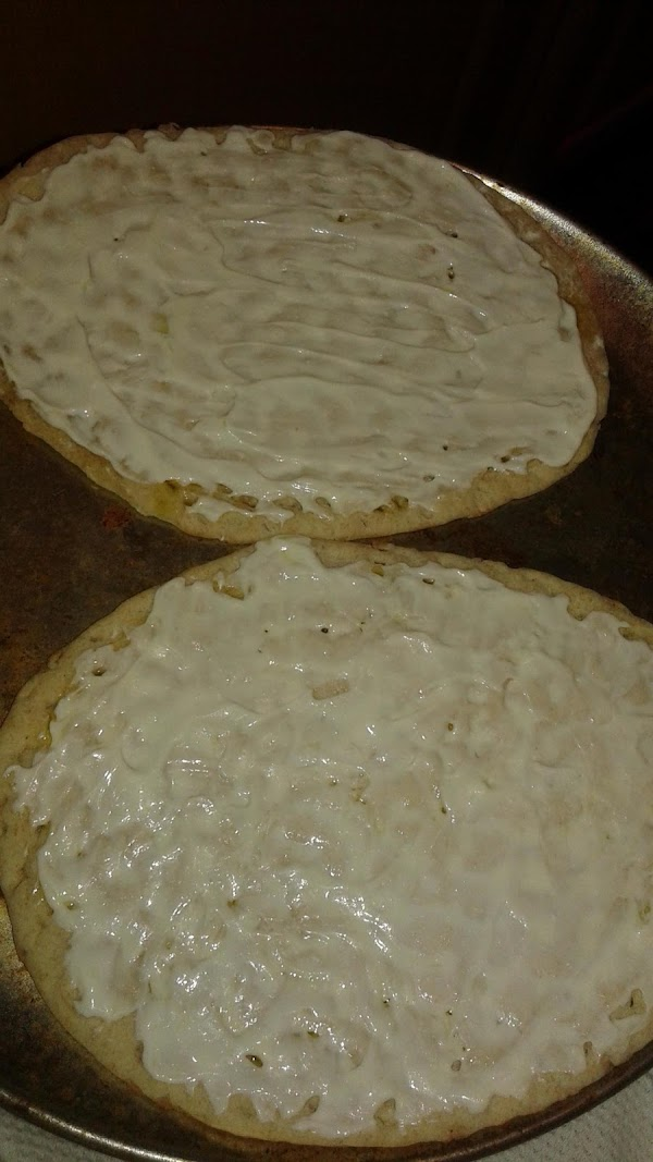 Drizzle the olive oil over the flatbread and then spread the greek yogurt over...