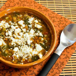 Slow Cooker Vegetarian Greek Lentil Soup with Tomatoes, Spinach, and Feta.