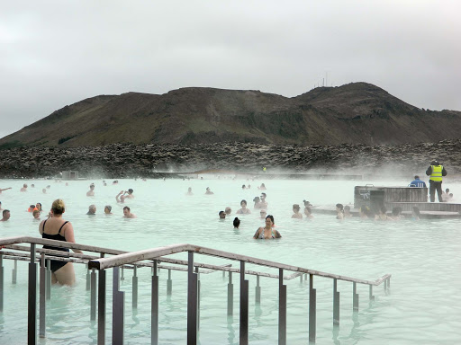 iceland-blue-lagoon.jpg - Visitors in the Blue Lagoon, a sulphur hot springs. In addition to travelers, doctors send patients there who have arthritis or are recovering from surgery or illnesses.