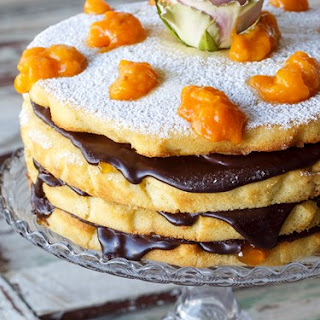 Easter Layered Vanilla Almond Sponge Cake With Apricots And Ganache.