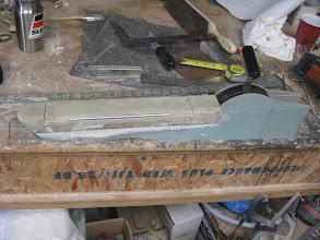 Photo: Armrest and throttle quadrant showing hinged storage bin door, Team Rocket throttle quadrant, and machined aluminum handle.