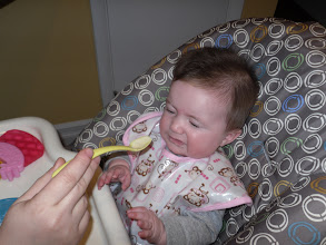 Photo: Olive's first solid food - rice cereal mush!