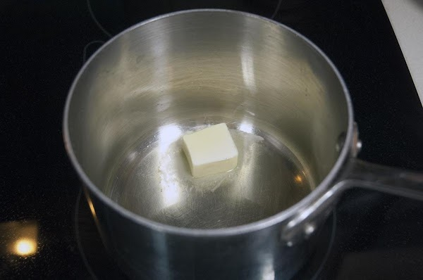 Add the grapeseed oil and butter to a saucepan over medium heat.