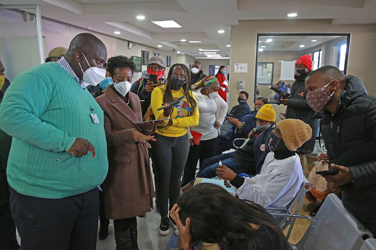Deputy public protector Kholeka Gcaleka (in brown jacket) and Dr Steve Mankupane (in green) interact with the public at Barangwanath Hospital on Wednesday.